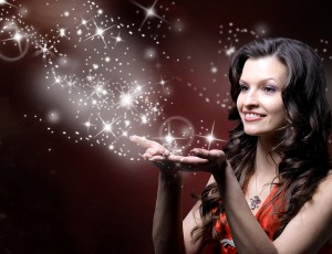 Woman blowing magic stars