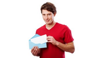 picture of man opening envelope